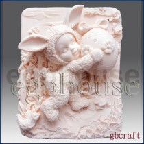Kid dresses up in Bunny Costume holding decorated egg - Detail of high relief sculpture
